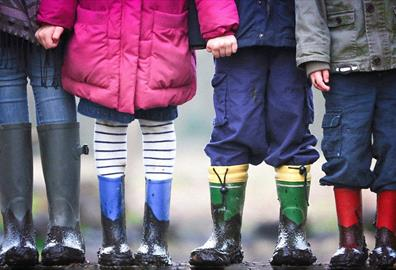Four kids with muddy boots