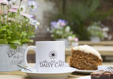 The Daisy Café mug and cake