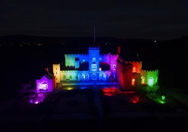 The Castle exterior lit up with colourful lights