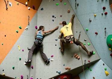 Two people climbing in Quay Climbing Centre