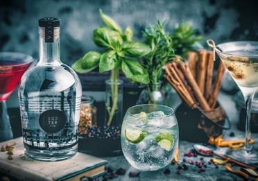 Exeter Gin presented in a glass with ice and a lime