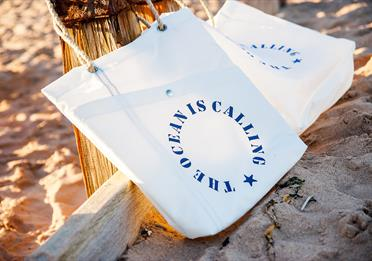 Sails and Canvas bag on the beach