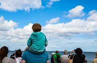 Kid watching the Torbay Airshow in Torquay Devon
