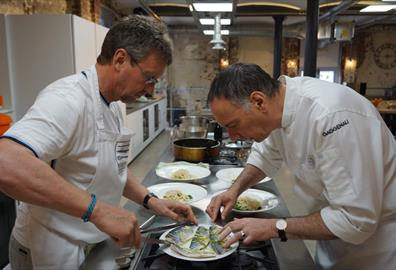 Jim and guest preparing and cooking the steamed seabass