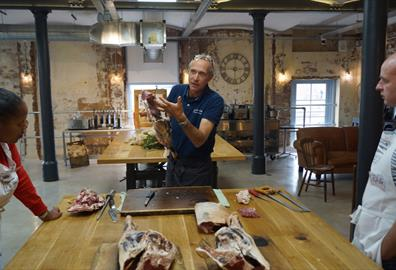 Pipers Farm founder, Peter Greig, talks students through the basics of butchery